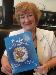 Hazel holding new Plato Book
