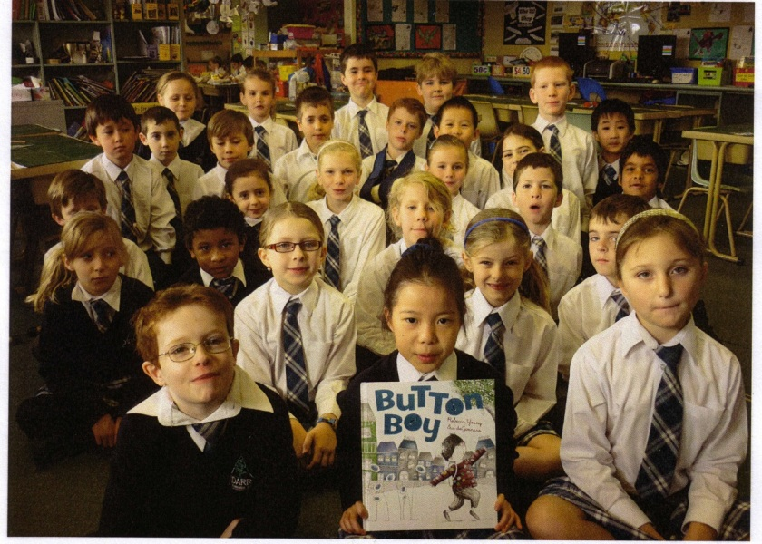 Yidarra Catholic Primary School students with a copy of Button Boy. Photo © K Price