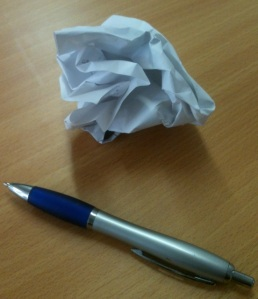 pen and scrunched up paper