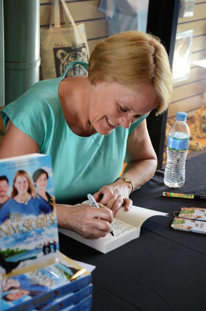 Wendy signing copies of The Nim Stories. Photo by Ryan Makepeace.