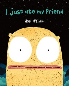 I just ate my friend by Heidi McKinnon. Image: Front cover of picture book. Black background and title of book is in teal. Illustration is a giant yellow alien head with owl like enormous white eyes.