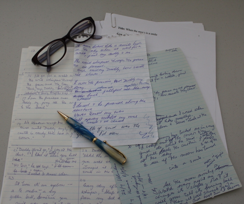 Drafts of When the Moon is a Smile, a pile of paper with scribbled notes.