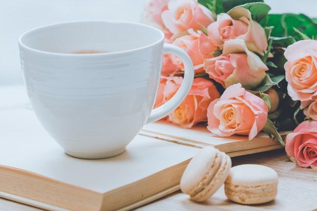 Photo of coffee and flowers by Ylanite Koppens via pexels.com