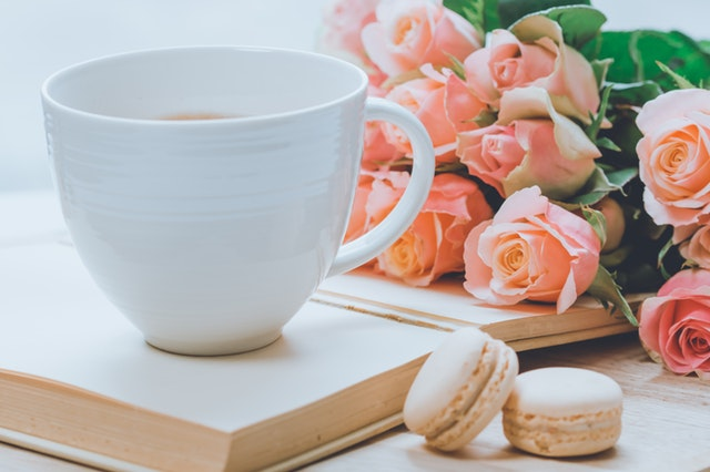 Photo of coffee and flowers by Ylanite Koppens via pexels.com