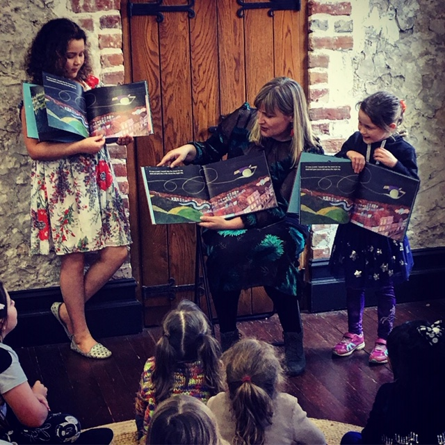 Amber reading with some helpers at the book launch