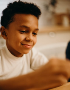 Child building something by hand. Photo from pexels.com